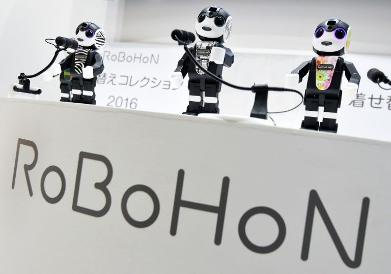 This photo taken on October 3, 2016 shows robot-shaped smartphones called 'RoBoHoN', developed by Sharp, on display at a press preview of the Combined Exhibition of Advanced Technologies (CEATEC) Japan in Chiba, in suburban Tokyo. Photo: AFP
