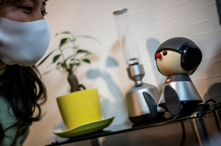 In this picture taken on February 4, 2021 shows Nami Hamaura talking with communication robot Charlie in her apartment in Tokyo. Photo: AFP