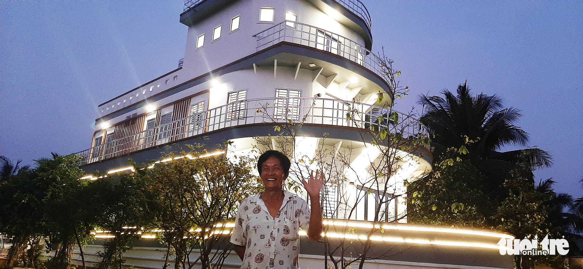 Cao Van Nam in front of his yacht-shaped house in Vinh Long Province, Vietnam, February 2021. Photo: Chi Hanh / Tuoi Tre
