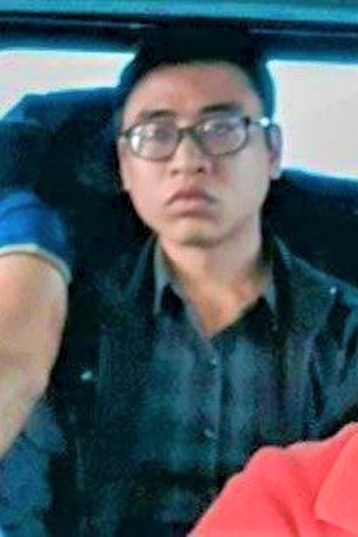 Tran Quoc Dung is being escorted to the police station in Khanh Hoa Province, Vietnam, February 27, 2021 in this supplied photo.