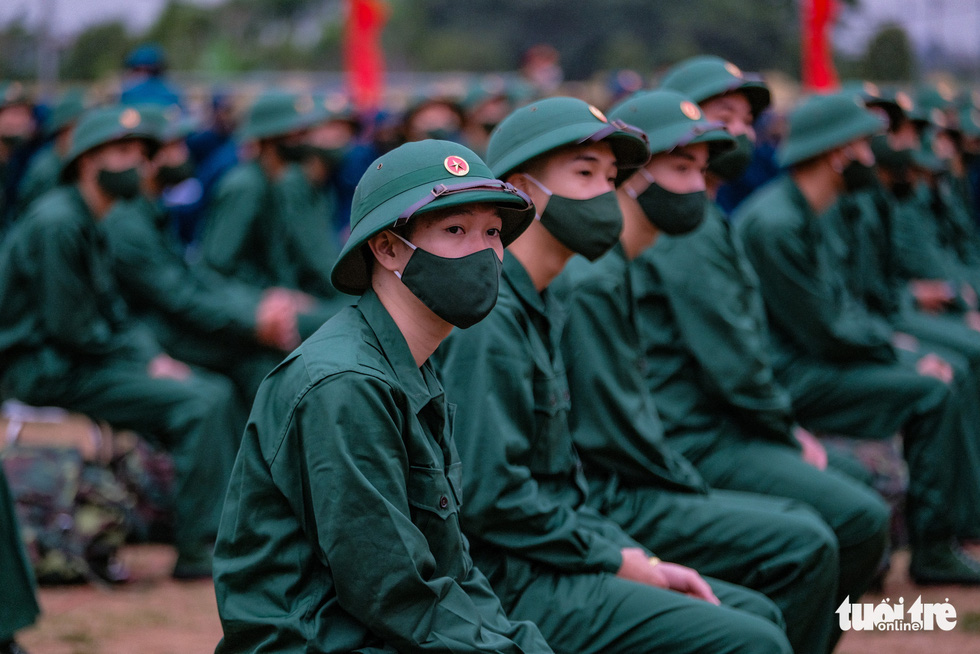 Enlistees from Hanoi's Dong Anh Province in the rookie handover ceremony, February 27, 2021. Photo: Nam Tran / Tuoi Tre