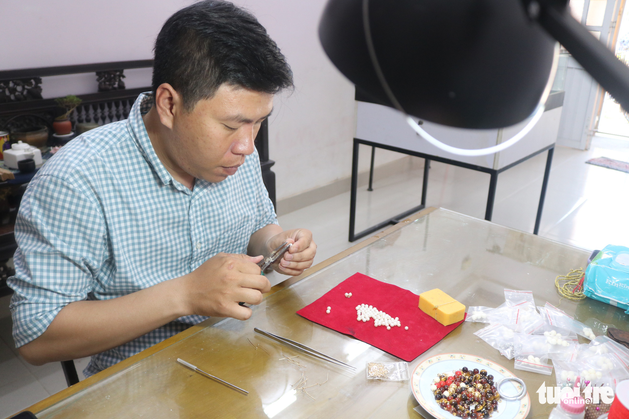 Tran Quang Minh Tan makes buttons for Nguyen Dynasty clothing