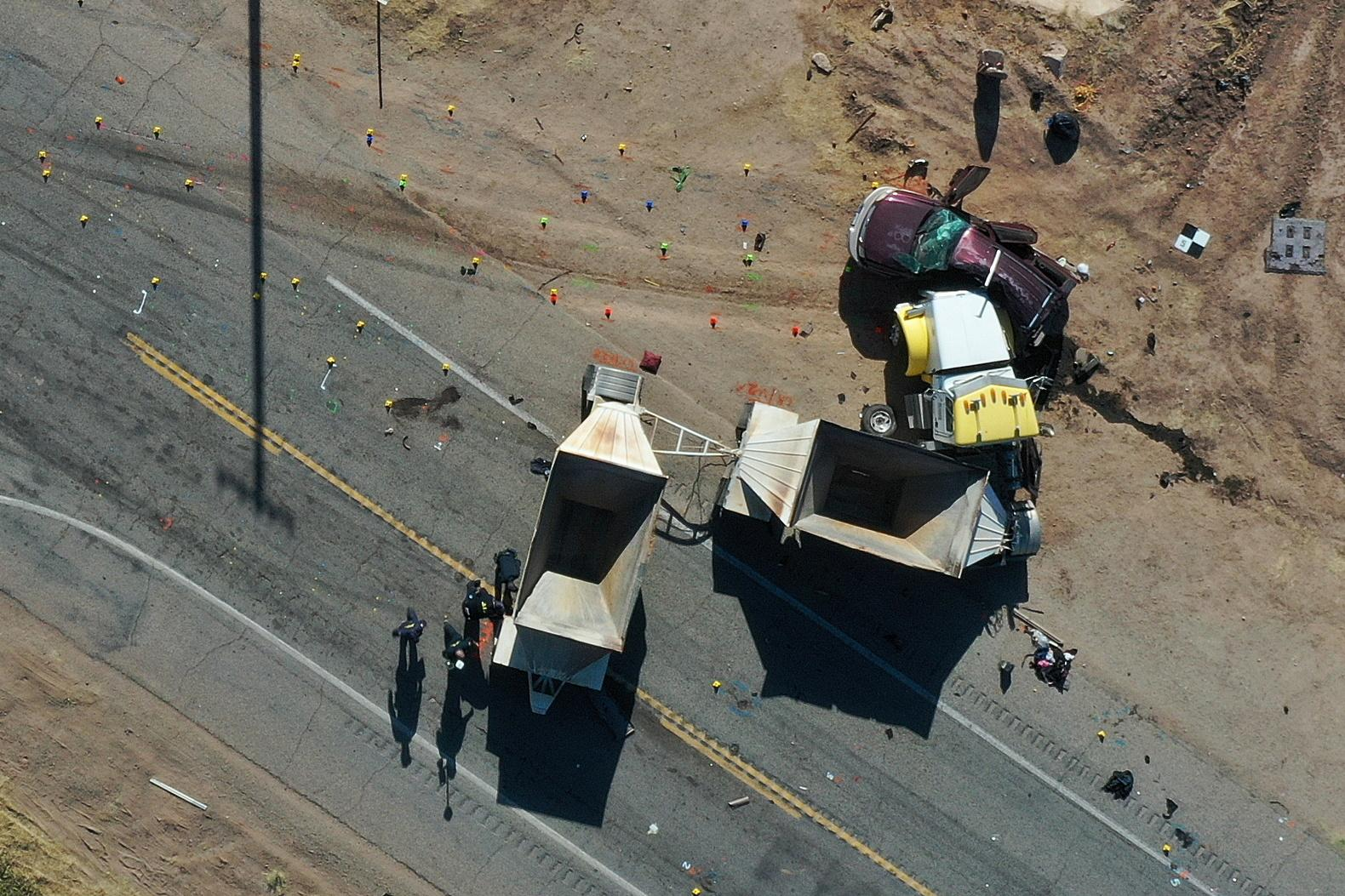 California Highway Patrol (CHP) officers investigate a crash site after a collision between a Ford Expedition sport utility vehicle (SUV) and a tractor-trailer truck near Holtville, California, U.S. in an aerial photograph March 2, 2021.  Photo: Reuters