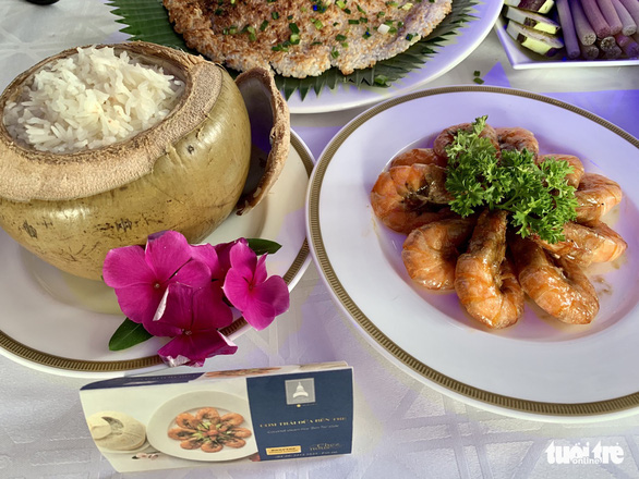 Coconut served with fried shrimp, a specialty from Ben Tre Province. Photo: Phuong Nam / Tuoi Tre