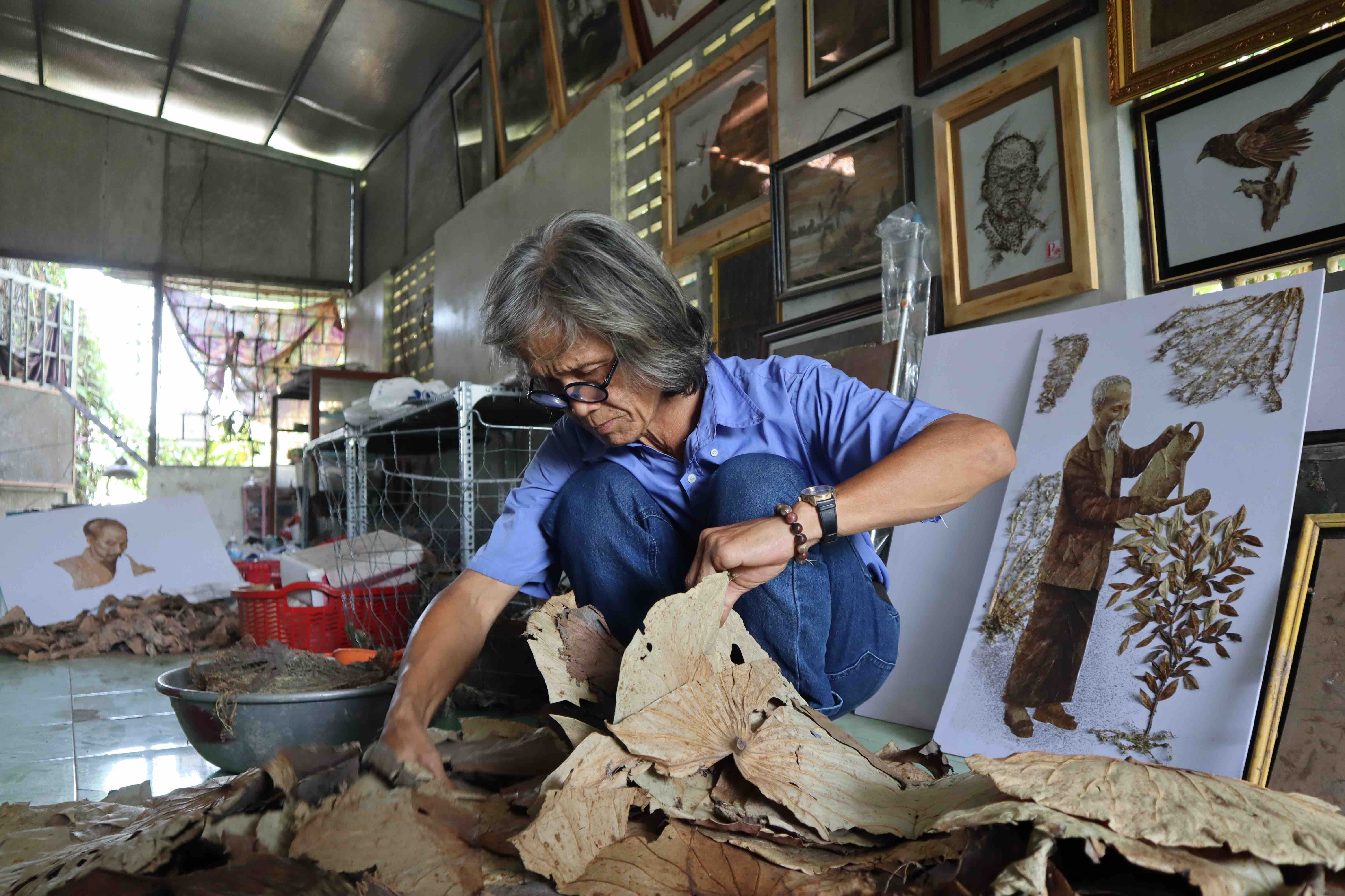 Le Van Nghia processes the lotus leaves at his workshop in Dong Thap, southern Vietnam. Photo: Nam Vuong / Tuoi Tre