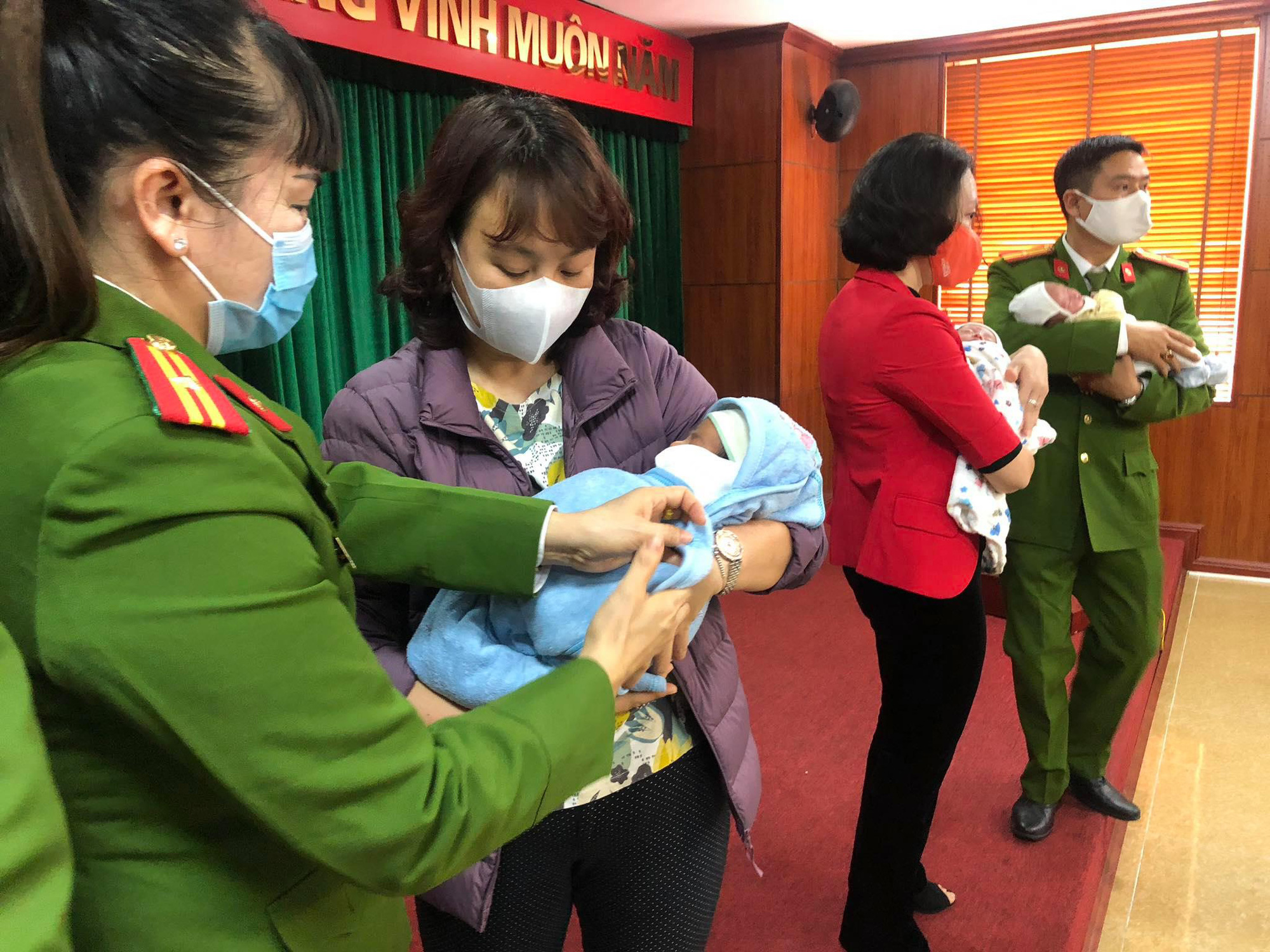 Vietnamese police officers rescue babies who were about to be trafficked to China in this supplied photo.