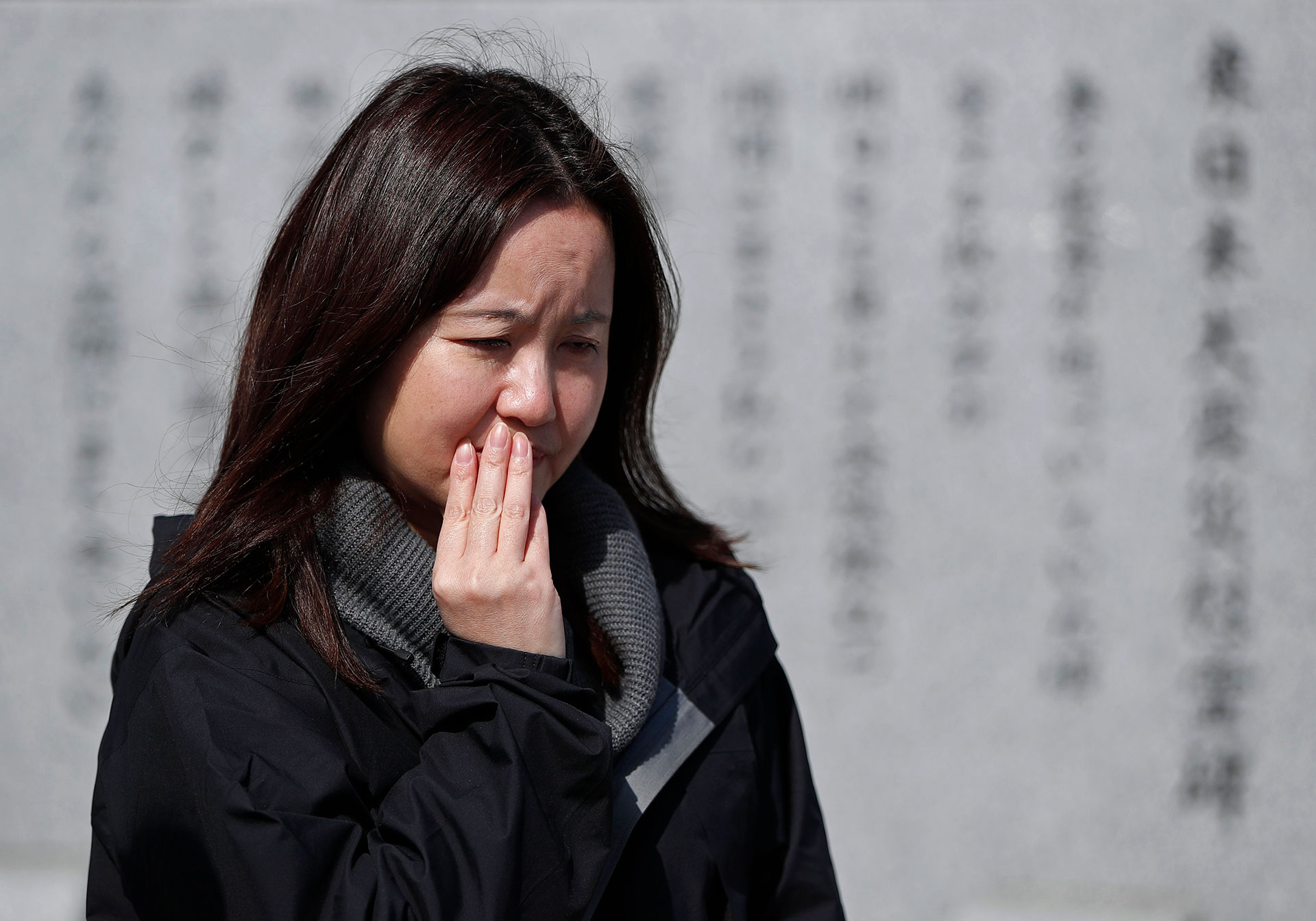Mika Sato, who lost her daughter Air, in the tsunami, heard from neighbors that they could hear children calling for help hours after the wave hit her town. Photo: Reuters