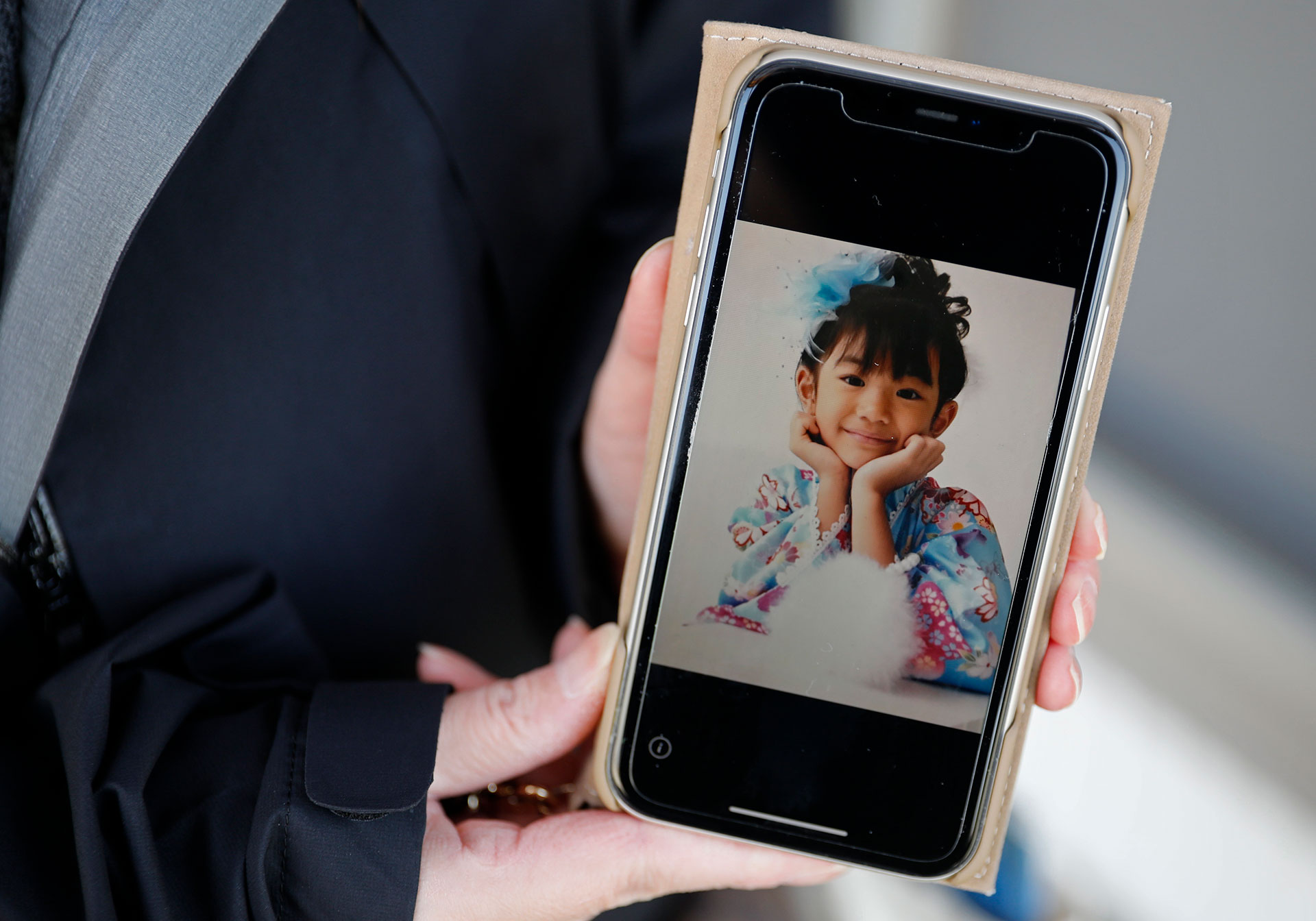 Sato shows a photo of Airi, who loved playing with her little sister and wanted to be a TV presenter when she grew up. Photo: Reuters