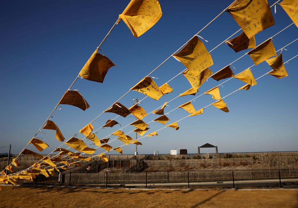 Yellow handkerchiefs bearing messages supporting people in areas hit by the 2011 earthquake and tsunami are hanged at Iwaki 3.11 Memorial and Revitalisation museum ahead of the ten years anniversary of the disaster in Iwaki, Japan, March 10, 2021. Photo: Reuters