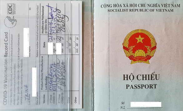 Supplied photo shows the Vietnamese passport and COVID-19 vaccination certificate of doctor Calvin Q. Trinh.