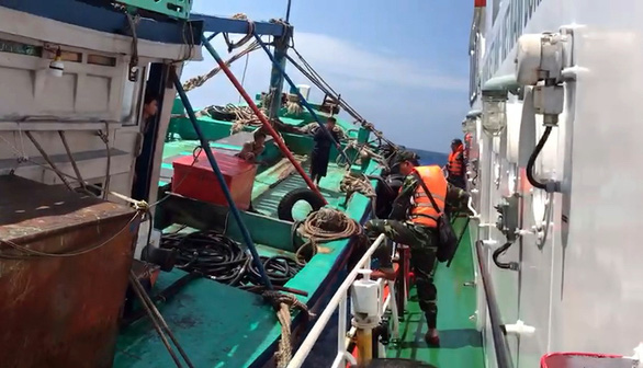 This supplied photo shows the border guards from the Con Dao border post inspecting a suspicious fishing vessel on the waters off Ba Ria - Vung Tau Province, Vietnam, March 13, 2021.