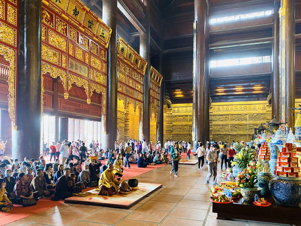 Visitors crowd a prayer room at Tam Chuc Pagoda Complex, the country's largest Buddhism compound, on March 14, 2021 in this supplied photo.