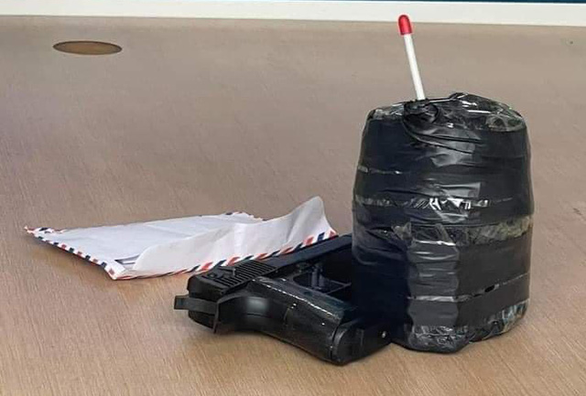This supplied photo shows a gun look-alike and a mass wrapped with black tape used by a man during a bank robbery in Phuc Tho District, Hanoi, March 15, 2021.