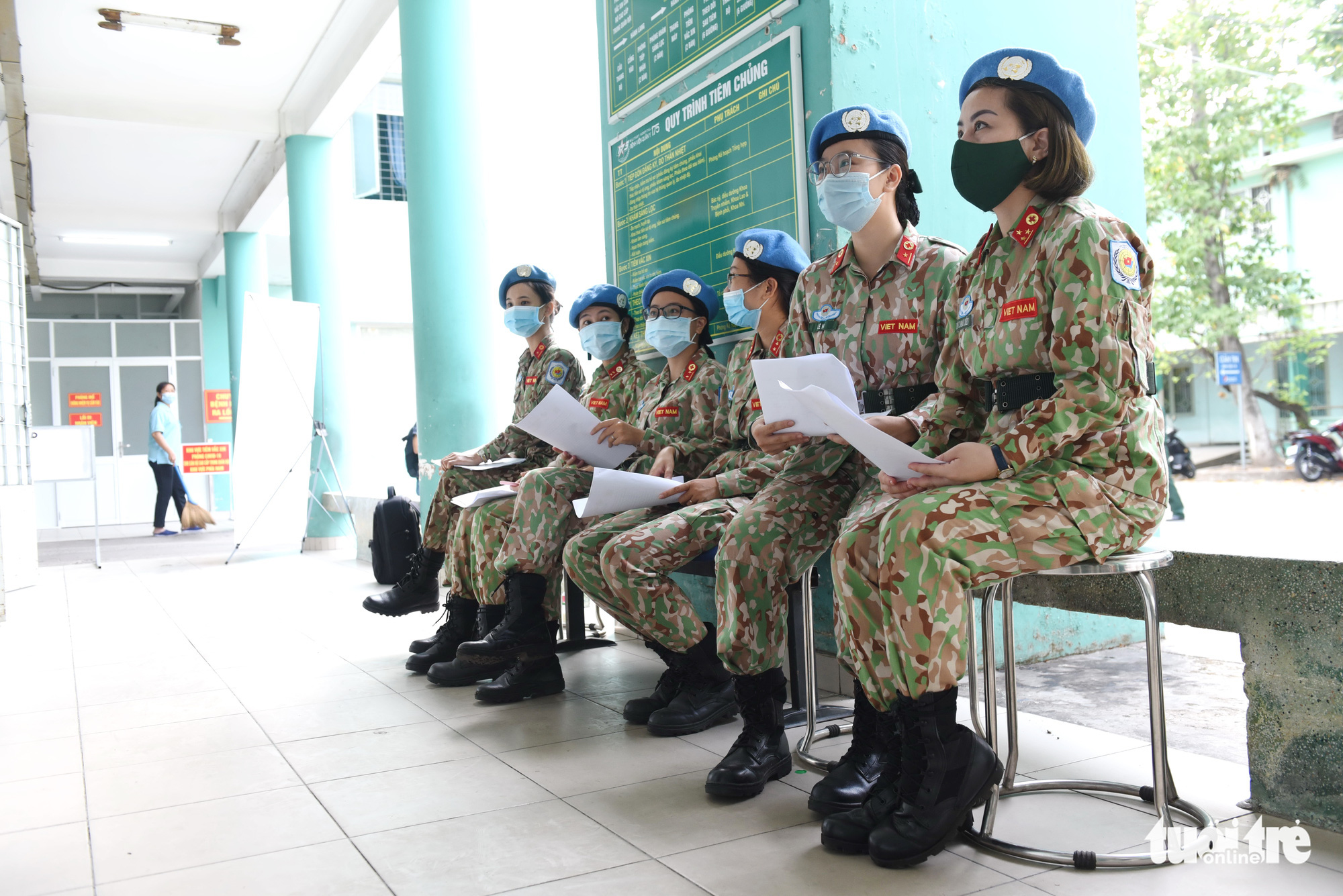 Female soldiers in charge of UN peacekeeping missions wait for their turn to get vaccinated at 175 Military Hospital in Ho Chi Minh City, March 16, 2021. Photo: Duyen Phan / Tuoi Tre